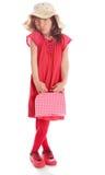 La chica joven en una alineada roja Foto de archivo