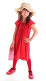 La chica joven en una alineada roja Imagen de archivo libre de regalías