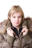 La chica joven en una chaqueta Fotografía de archivo libre de regalías