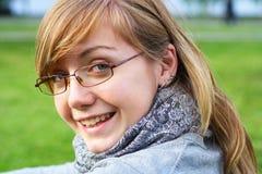 La chica joven en vidrios Fotografía de archivo libre de regalías