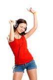 La chica joven escucha música Fotografía de archivo libre de regalías