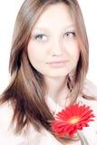 La chica joven hermosa con la flor roja aisló Imágenes de archivo libres de regalías