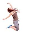La chica joven que salta para la alegría Fotos de archivo libres de regalías