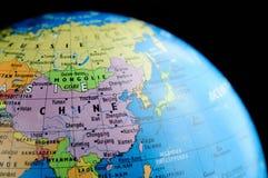La Chine dans le globe Images libres de droits