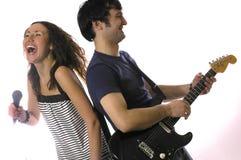 La chitarra e la donna dell'uomo Fotografia Stock Libera da Diritti