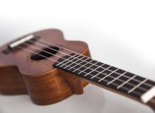 La chitarra marrone delle ukulele immagine stock