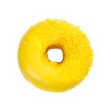 La ciambella con la glassa gialla e spruzza fotografie stock