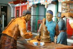 La Cina Asia, Pechino, il museo capitale, scultura, vecchia Pechino, clienti pieghi Fotografia Stock Libera da Diritti