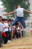 La Cina: Giochi dell'atletica leggera dell'allievo/salto lungo Fotografia Stock Libera da Diritti