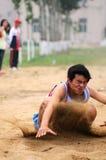 La Cina: Giochi dell'atletica leggera dell'allievo/salto lungo Immagine Stock Libera da Diritti