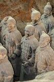 La Cina, Xi ` Figure dell'argilla dei guerrieri, dei cavalli e delle bighe Fotografie Stock