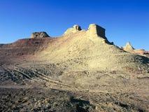 La Cina/Xinjiang: Castello del fantasma di Urho durante il tramonto Fotografia Stock Libera da Diritti