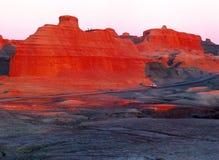 La Cina/Xinjiang: Castello del fantasma di Urho durante il tramonto Fotografia Stock