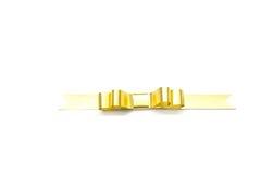 La cinta de oro espiral en blanco Imagenes de archivo