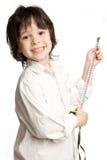 La cinta métrica larga del deseo del niño pequeño Fotos de archivo libres de regalías