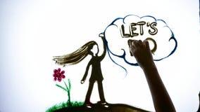 La cita de motivación, manos del hombre dibuja a la muchacha y la frase deja hace con la arena de la ayuda en la pantalla con la