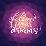 La citazione ispiratrice calligrafica 'segue i vostri sogni' Immagini Stock