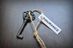 La clé à l'assurance Photos libres de droits