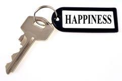 La clé au bonheur sur un fond blanc illustration stock