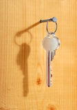 La clé s'arrête sur un clou. Photographie stock libre de droits
