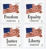 La clase de los E.E.U.U. primeros señala para siempre sellos por medio de una bandera Fotografía de archivo libre de regalías