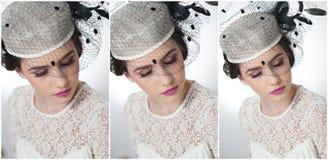 La coiffure et composent - le beau portrait d'art de jeune fille Brune mignonne avec le chapeau et le voile blancs, tir de studio photographie stock libre de droits