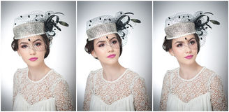 La coiffure et composent - le beau portrait d'art de jeune fille Brune mignonne avec le chapeau et le voile blancs, tir de studio images libres de droits