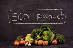La col, la coliflor, el bróculi y la mano dibujados firman el producto del eco Foto de archivo