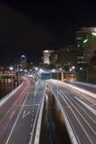 La cola de la autopista enciende Brisbane Imágenes de archivo libres de regalías