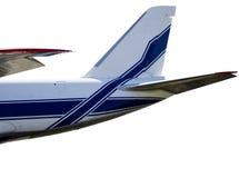 La cola del avión en un fondo blanco con la trayectoria de recortes Fotografía de archivo