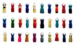 La colección de muchos colorea el vestido del vestido de noche en maniquí Imágenes de archivo libres de regalías