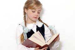 La colegiala con el libro en manos Fotos de archivo
