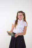 La colegiala en la blusa blanca con los vidrios odia la preparación Imagen de archivo libre de regalías