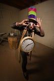 La colle maladroite avec la grande horloge Image stock
