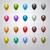 La collection d'hélium monte en ballon coloré avec des rubans sur Grey Background Holiday Decoration Set Image libre de droits