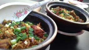 La comida china del arroz del pollo de Claypot atasca a amantes asiáticos de la comida de Malasia Fotos de archivo libres de regalías