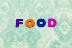 La comida come letras de los niños de la nutrición de la comida buenas imagenes de archivo