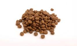 La comida seca del gato o de perro adentro trituró la forma Imagen de archivo