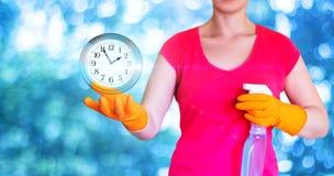La compañía de la limpieza muestra tiempo Imagenes de archivo