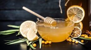 La composición del té con el limón y la miel imagen de archivo