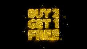 La compra 2 consigue 1 tipografía libre escrita con las partículas de oro chispea los fuegos artificiales