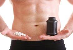 La compressa di resistenza delle pillole inscatola l'uomo di supplementi isolato Immagini Stock
