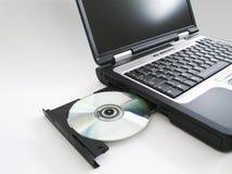 La computadora portátil w/cd expulsó I fotos de archivo