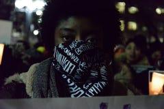 La comunidad negra de Toronto toma medidas en solidaridad con los manifestantes de Ferguson imágenes de archivo libres de regalías