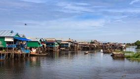 La comunità della riva del fiume Fotografie Stock