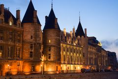 La Conciergerie. Twilight view of the Conciergerie (old medieval jailhouse) - Paris, France royalty free stock images