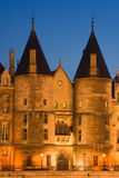 La Conciergerie. Twilight view of the Conciergerie (old medieval jailhouse) - Paris, France stock photo