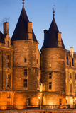 La Conciergerie. Twilight view of the Conciergerie (old medieval jailhouse) - Paris, France royalty free stock photo