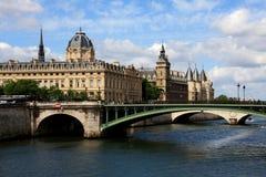 La Conciergerie. Day view of the Conciergerie (old gothic jailhouse) and the Seine river - Paris, France royalty free stock photo