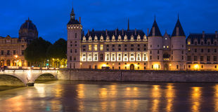 La Conciergerie in the night Stock Images